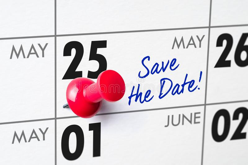 Wall calendar with a red pin - May 25 stock photography