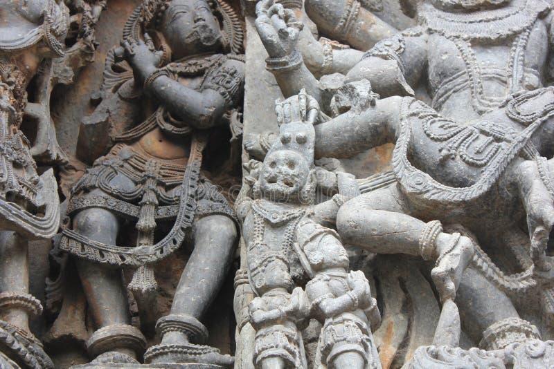Hoysaleswara Temple wall carving of lord narasimha lion faced hindu god scalping a demon stock image