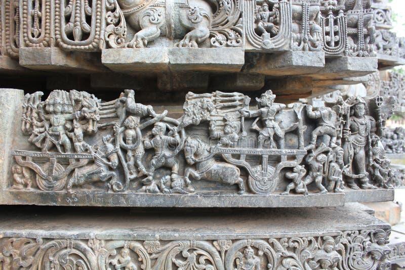 Hoysaleswara Temple wall carving of Ramayana battle scene - Rama fighting with Ravana royalty free stock photo