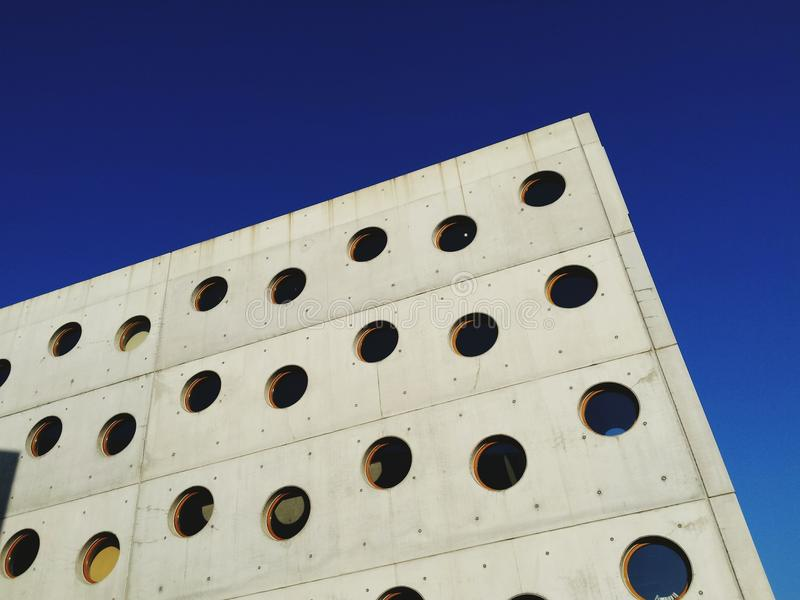 Wall with circle windows stock photography