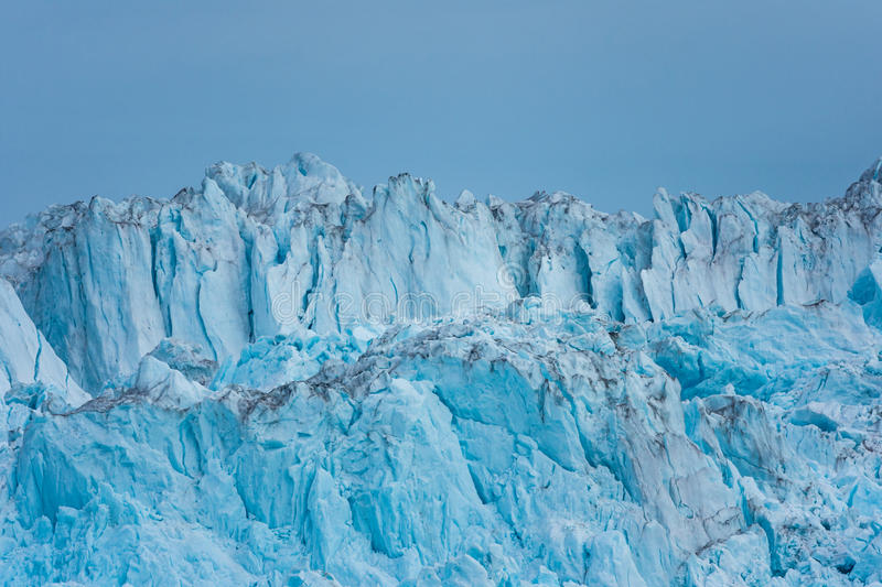 Wall of the claving Eqi glacier, Greenland royalty free stock photography