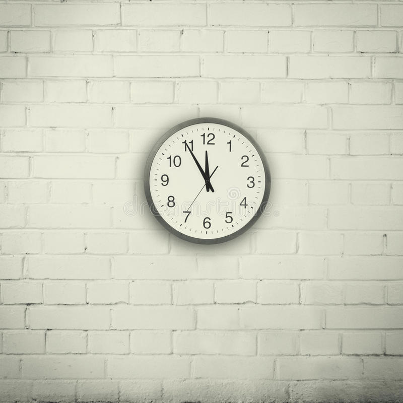Wall with a clock stock images
