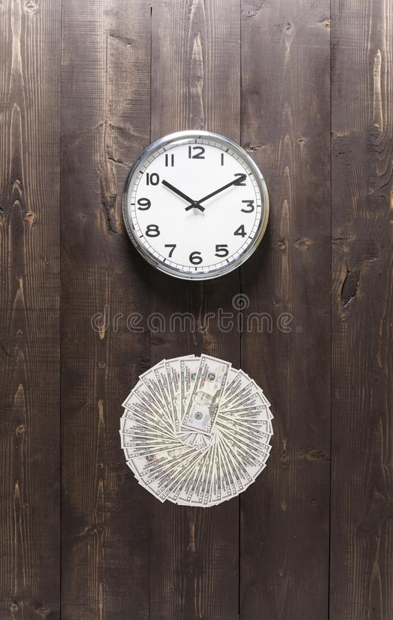 Time and Money. Wall clock and American currency. Time is money concept stock photos