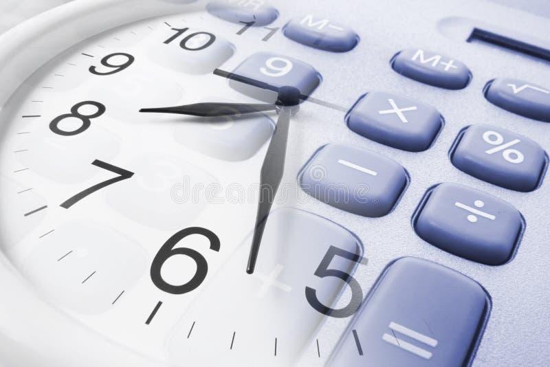 Wall Clock and Calculator royalty free stock photo