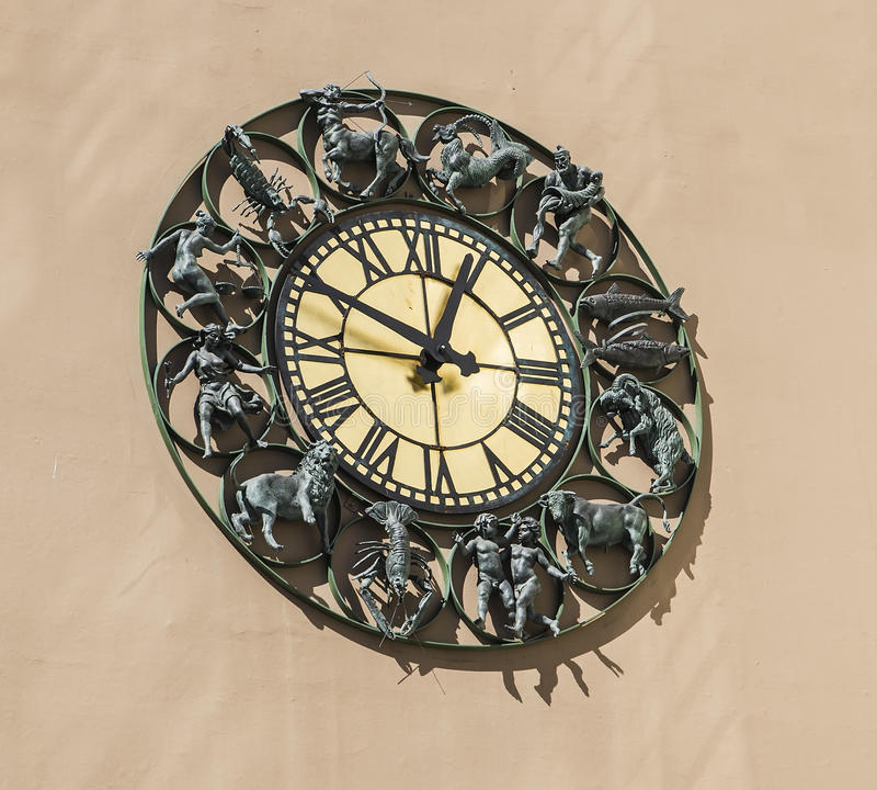 Wall clock with figurines zodiac signs royalty free stock photography