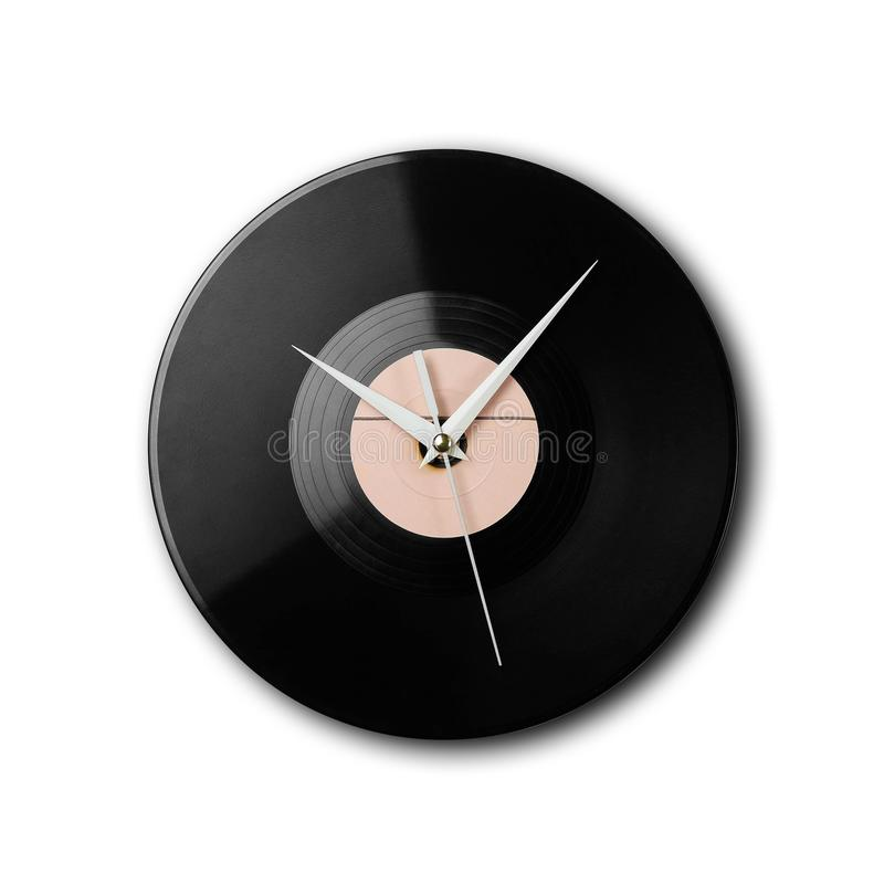 Wall clock in the form of ancient black gramophone records. Close up. Isolated on white background royalty free stock photo