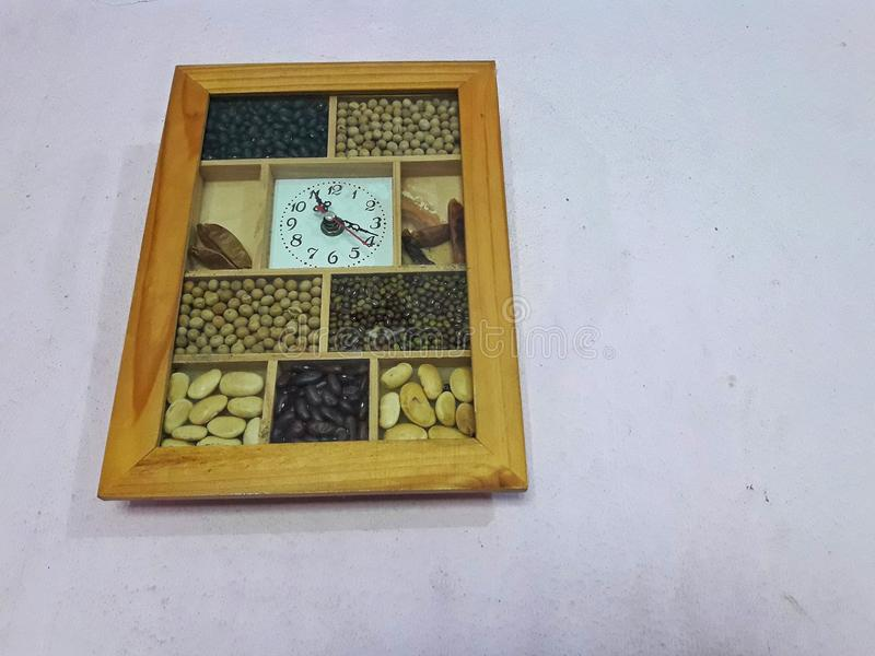 Wall clock with full of nuts inside its frame. This is a wall clock with full of nuts inside its frame royalty free stock image