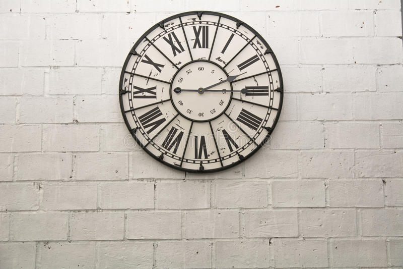 A wall clock on rock wallpaper background royalty free stock photography