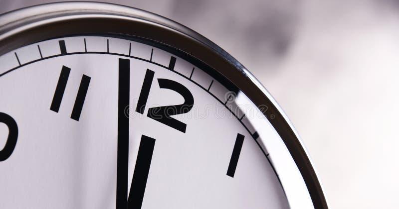 Wall clock showing five to twelve.  stock photos