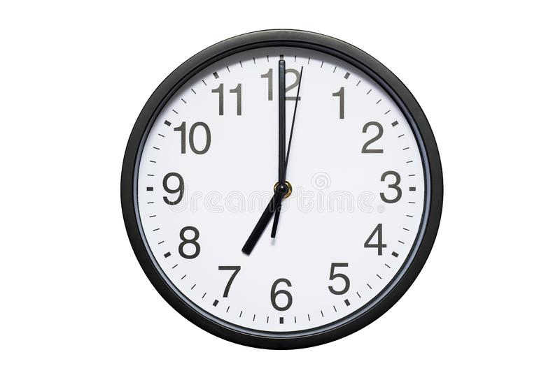 Wall clock shows time 7 o`clock on white isolated background. Round wall clock - front view. Nineteen o`clock stock photography