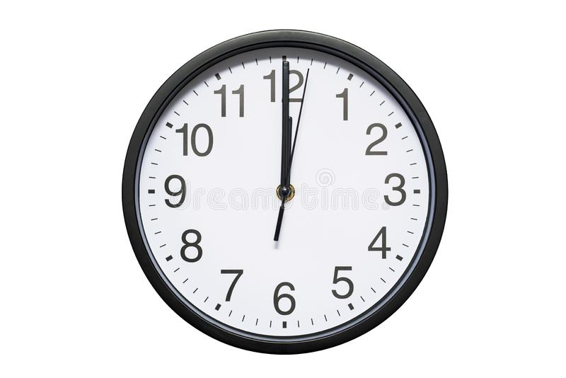 Wall clock shows time 12 o`clock on white isolated background. Round wall clock - front view. Twelve o`clock royalty free stock photo