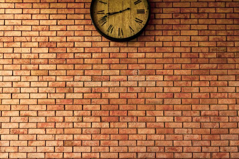 Wall Clock vintage retro styles hanging on the brick wall. royalty free stock photography