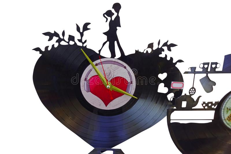 Wall clock from a vinyl record. Original romantic wall record made from old vinyl record royalty free stock images