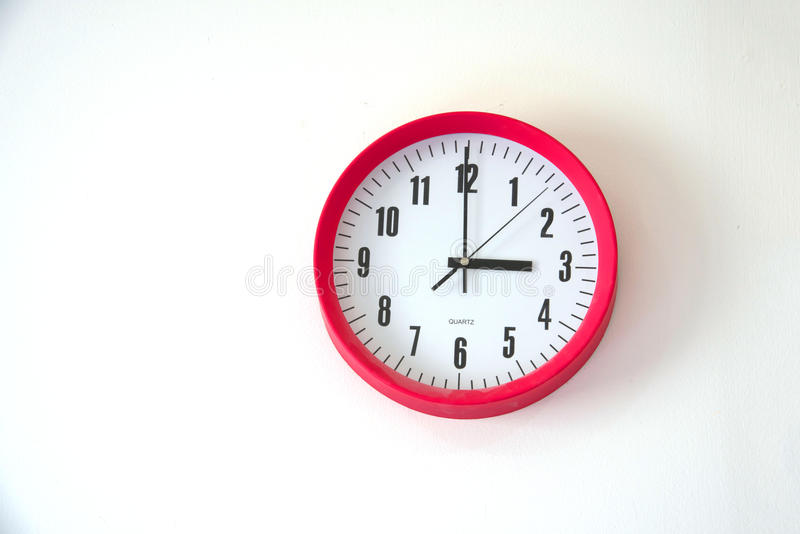 Wall clock on white background. At tree o`clock stock photo