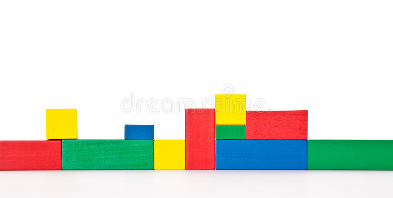 Wall of colored building blocks. All on white background stock image
