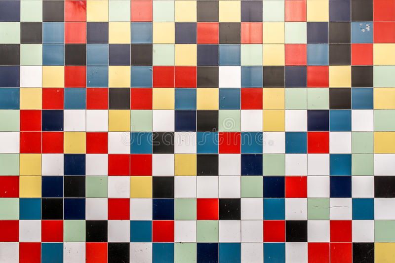 A wall of colored tiles. A wall of colored square tiles stock photography