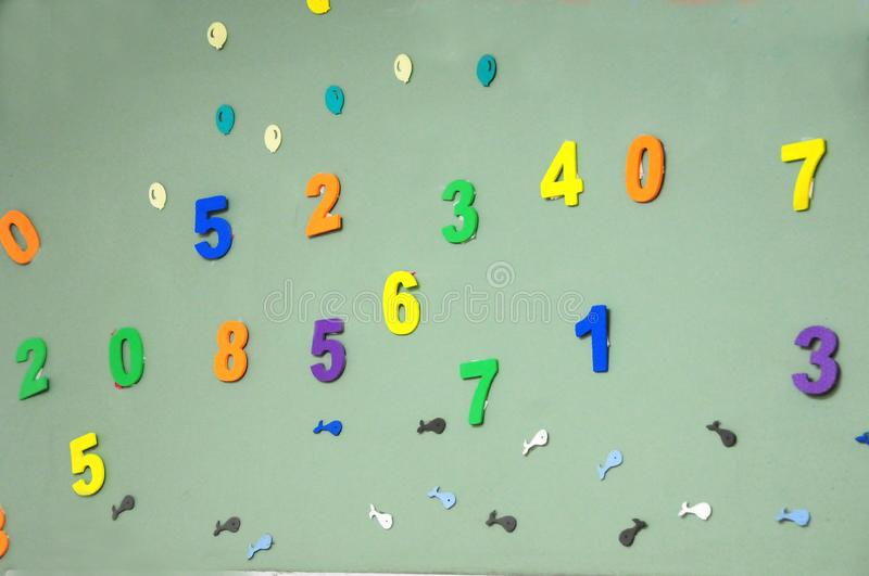 Wall with colorful children`s numbers stock photography