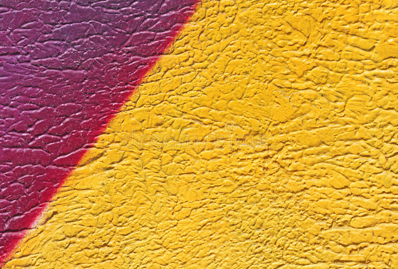 Wall with colorful yellow paint pattern paint royalty free stock photo