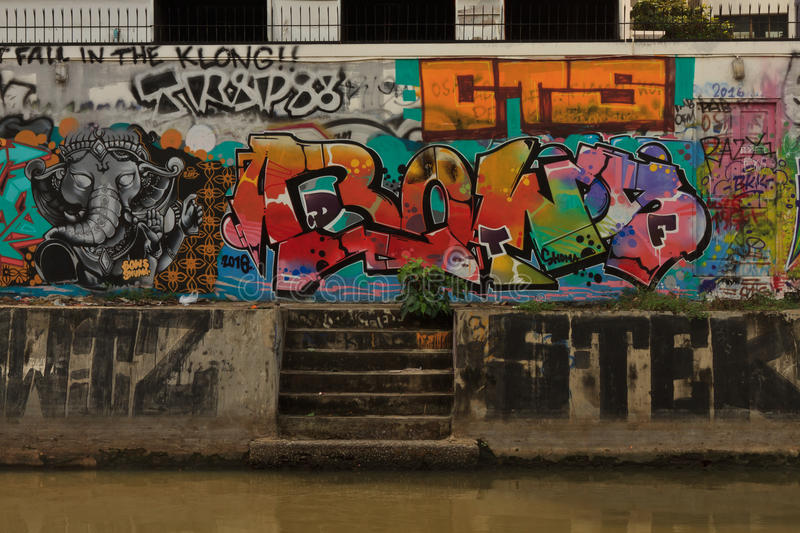 The wall completly covered by bright street graffities in Bangkok, Thailand stock image