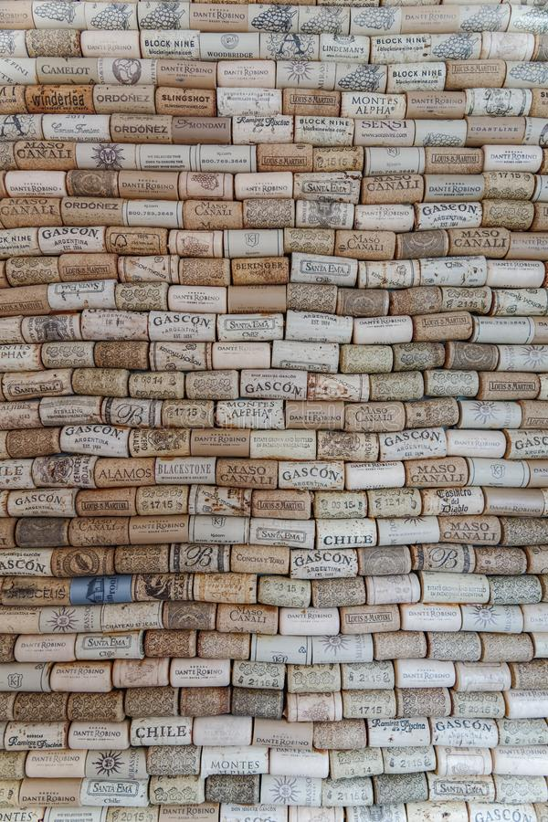 Wall covered with corks from various wineries royalty free stock photos