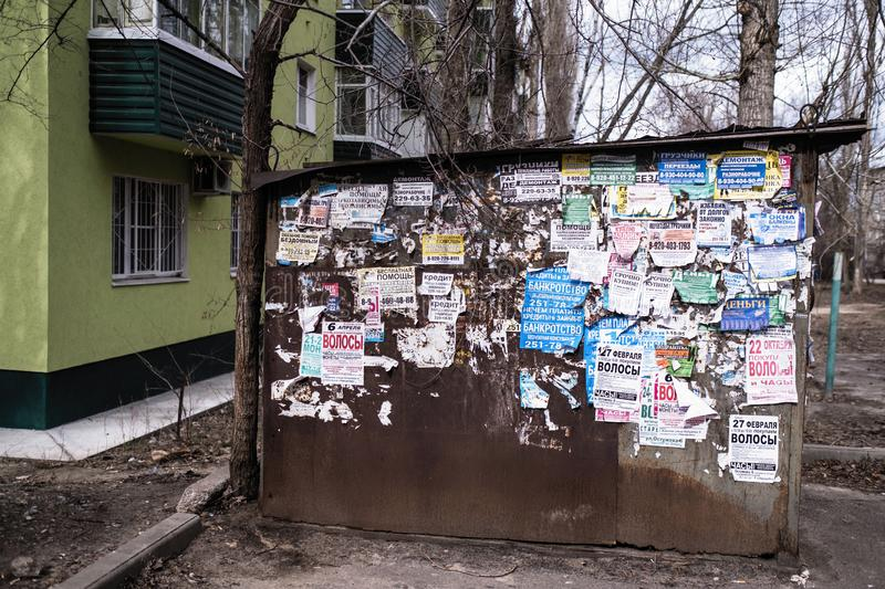 The wall is covered with old ads. royalty free stock photography