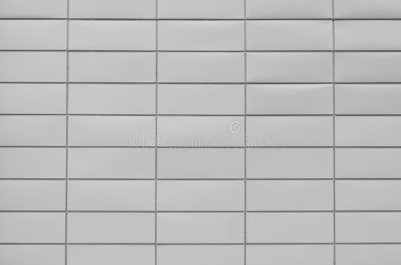 Wall covered with rectangular gray metal plates stock photography