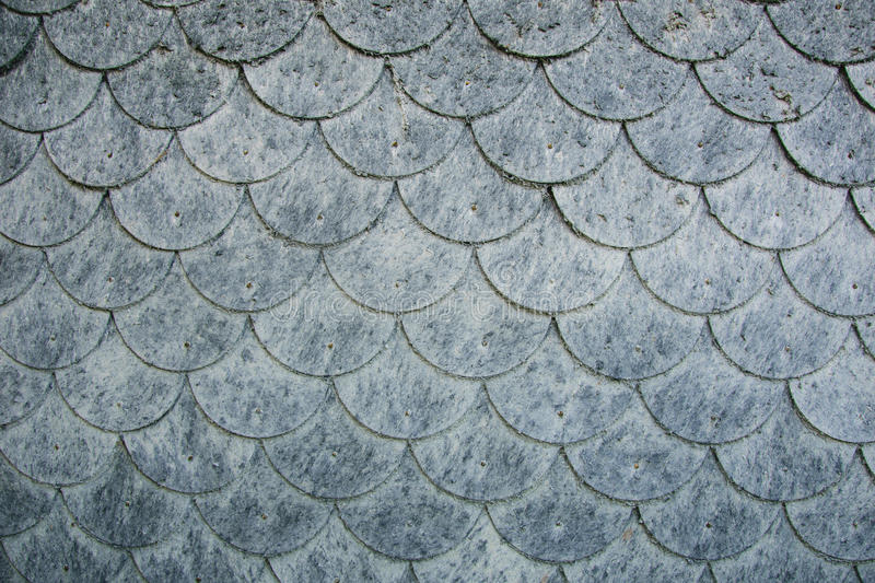 Wall covered with scaly elements of fibrous material flake.  royalty free stock image