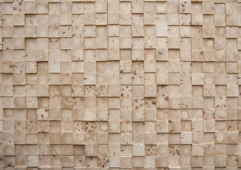 Decorative wall full of square slats cut from pine wood. Wall covered with square slats of cut pine wood. The woods form an interesting geometric texture..PHOTO stock images