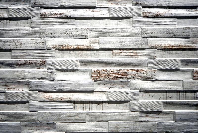 Wall covering for interior made of stoneware with scratched painted wood effect royalty free stock image