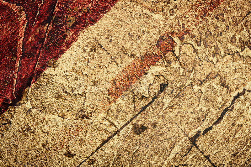 Wall decor texture. Red with golden bumpy wall stucco texture background royalty free stock photography