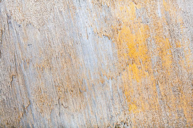 Wall decor texture. White and golden messy wall stucco texture background. Decorative wall paint royalty free stock photos