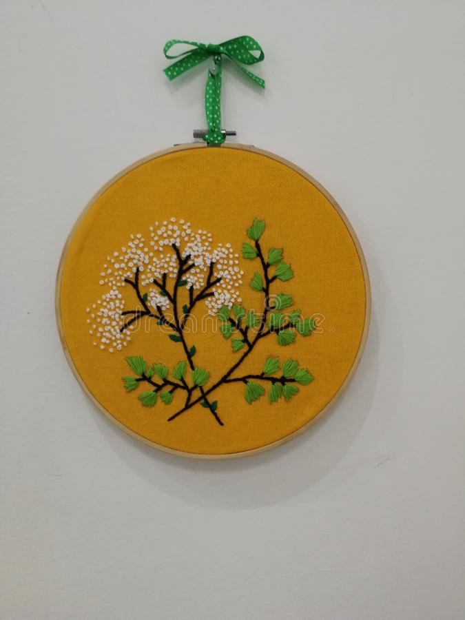 Wall decor. Yellow wall decor made with an embroidery hoop royalty free stock images