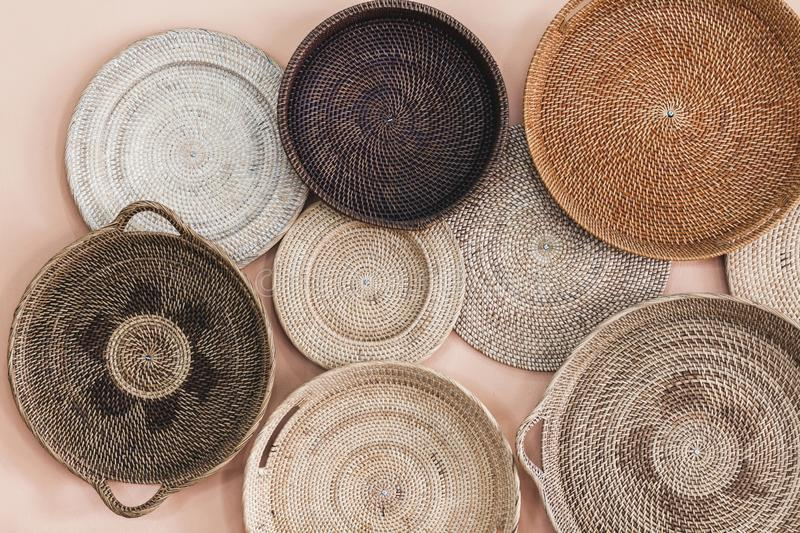 Wall decorated with different wicker handmade tray stock photo