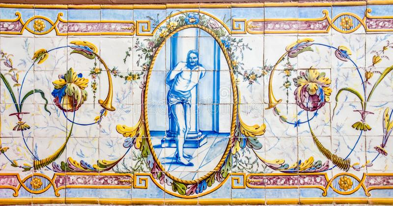 Historical ceramic tile wall decoration of Jesus Christ in a Portuguese church stock image