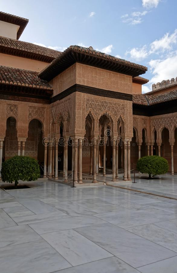 Patio of the Lions at Nasrid palace of the Alhambra in Granada, Andalusia. Wall decorations with arabesque ornaments at the Lions Palace court of the Nasrid royalty free stock photo