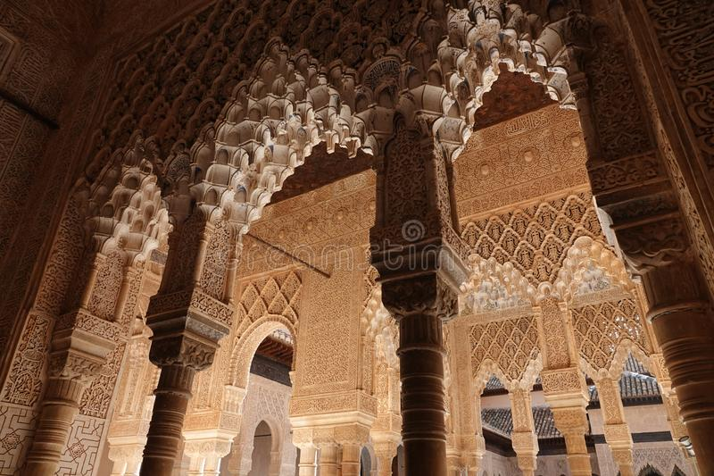Arches at Lions court of Nasrid palace of the Alhambra in Granada, Andalusia. Wall decorations with arabesque ornaments at the Lions Palace of the Nasrid complex royalty free stock image