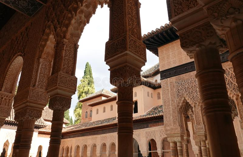 Arches to Lions court at Nasrid palace of the Alhambra in Granada, Andalusia. Wall decorations with arabesque ornaments at the Lions Palace of the Nasrid complex stock photo