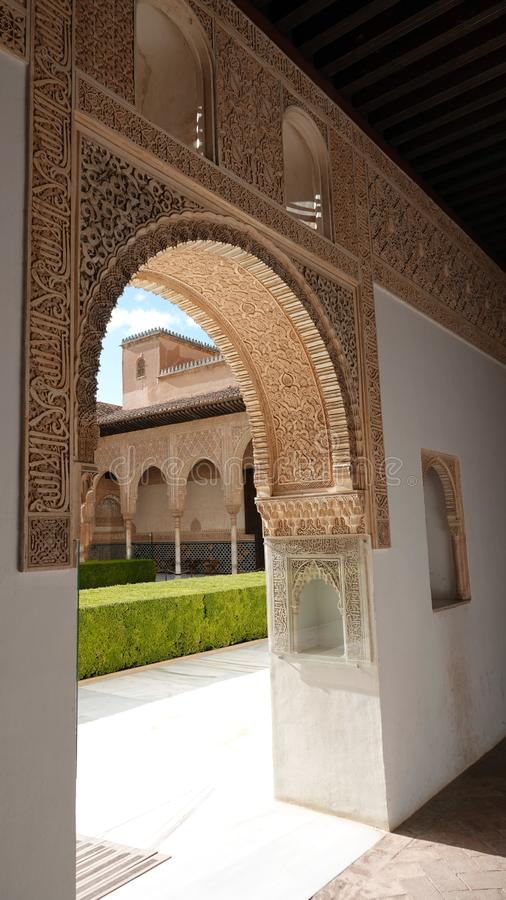 Arch to Palacio de Comares at Nasrid palace of the Alhambra in Granada, Andalusia. Wall decorations with arabesque ornaments at the Palacio De Comares at the royalty free stock photo