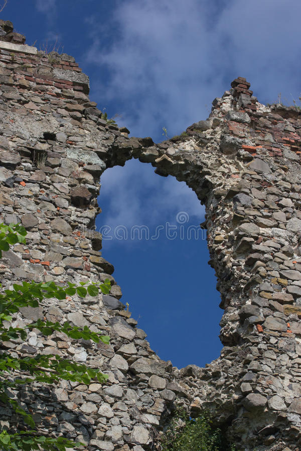The wall of destroyed old medieval castle stock image