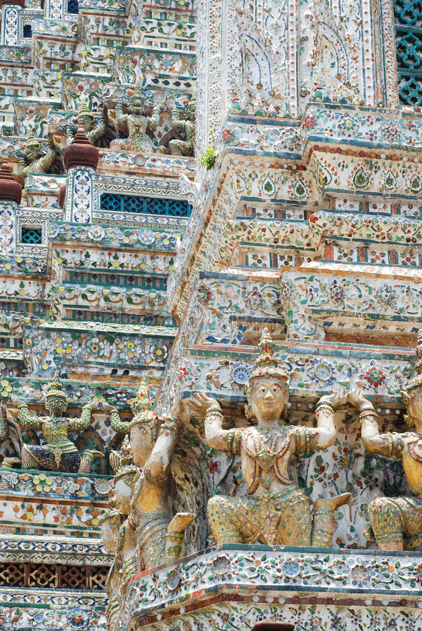 Wall detail of Wat Arun. Wat Arun is among the best known of Thailand's landmarks and the first light of the morning reflects off the surface of the temple with royalty free stock photos