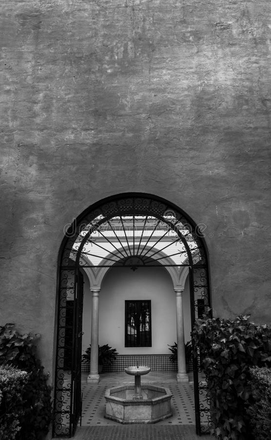 Wall, door and patio in the Alcazar of Sevilla. In Spain royalty free stock photography