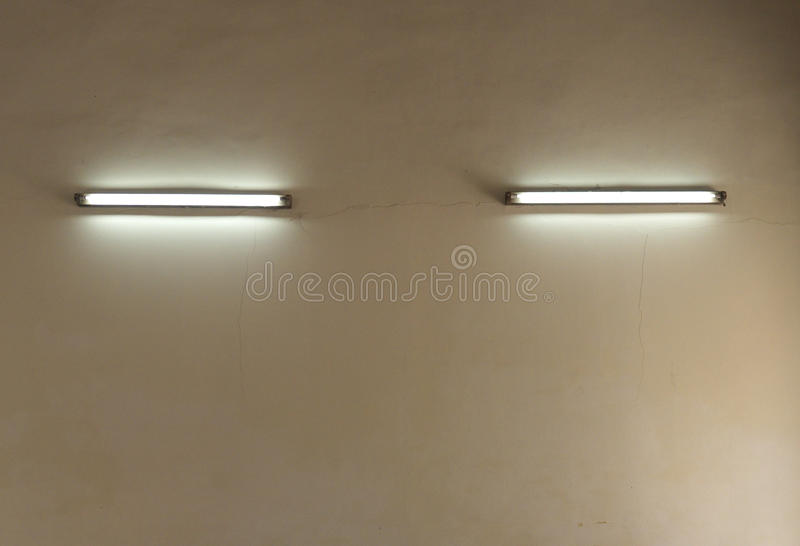 Wall of electric lamp. The wall and neon lamp royalty free stock photo