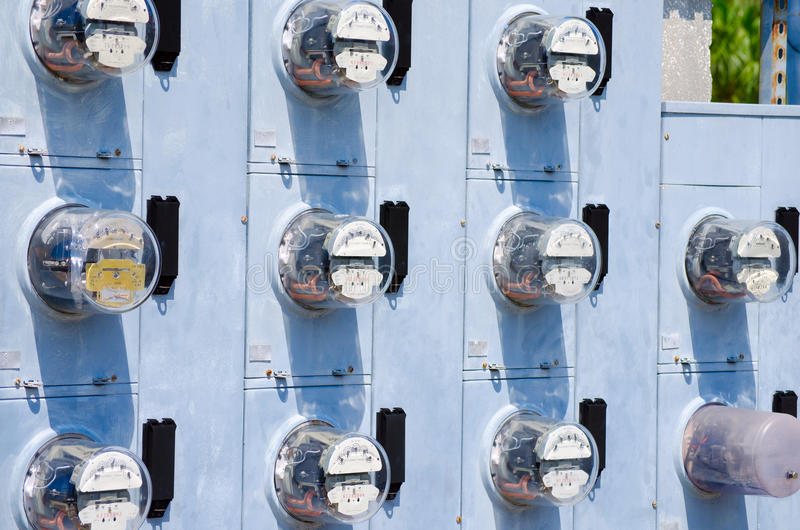 Wall of electric meters stock images