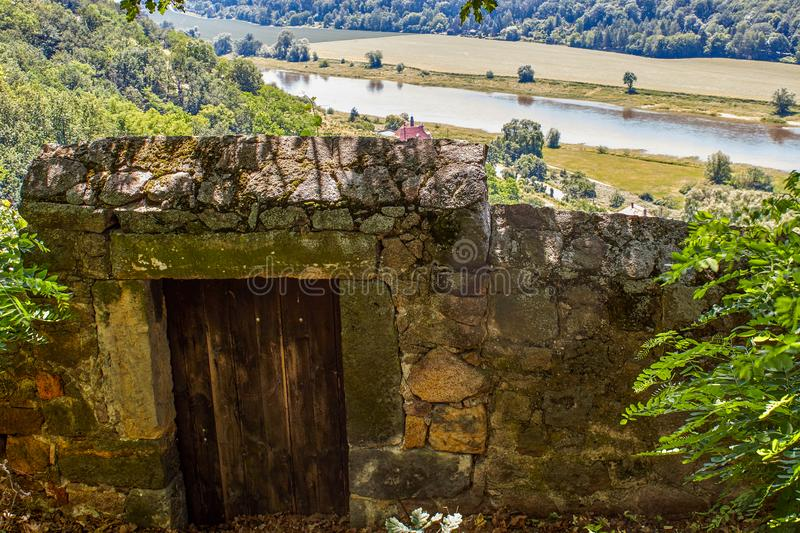 Wall with entrance door to the vineyard in the Saxon Spaargebirge stock image