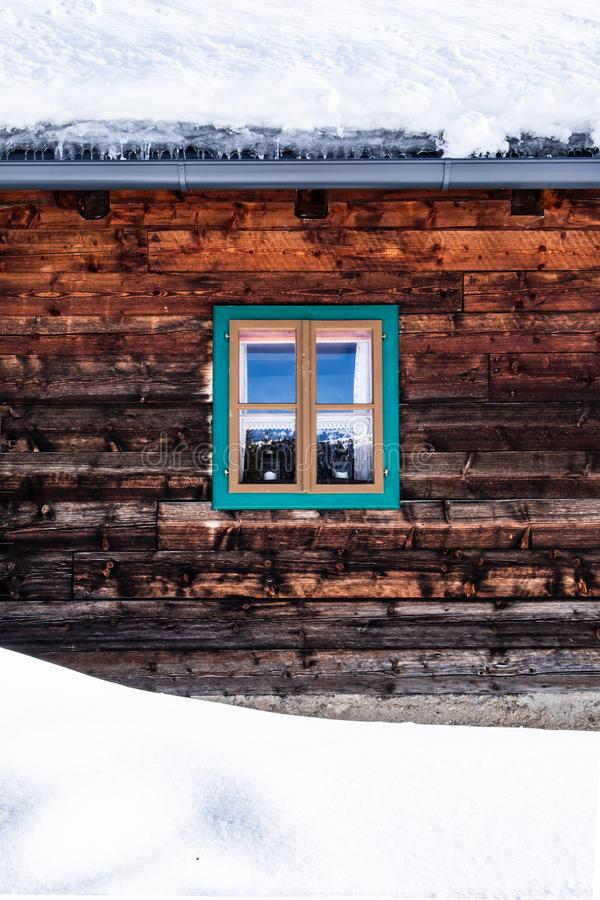 Wall, facade of old wooden house, hut with small window stock photography