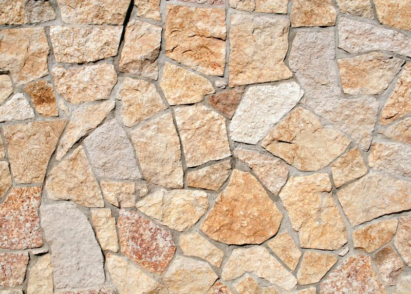 Wall faced with colorful decorative stone royalty free stock photo