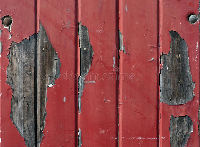 Wall with flaking red paint royalty free stock photo