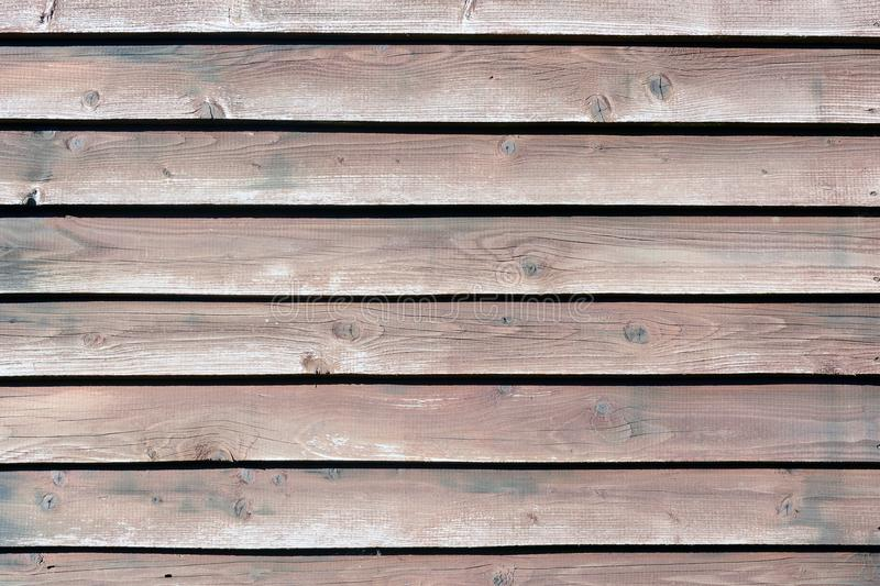 Wall of flat boards. Wooden horizontal slats. Background with brown wood texture. Wall of flat boards. Wooden horizontal slats. Beautiful background with brown stock image