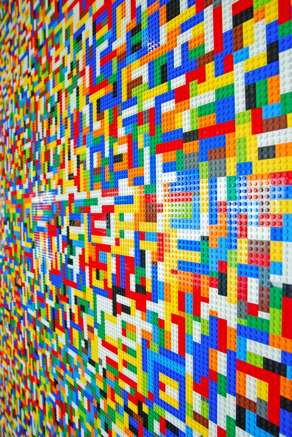 A Wall full of Lego Pieces. Side Vertical View of A Wall full of Colorful Lego Pieces royalty free stock image