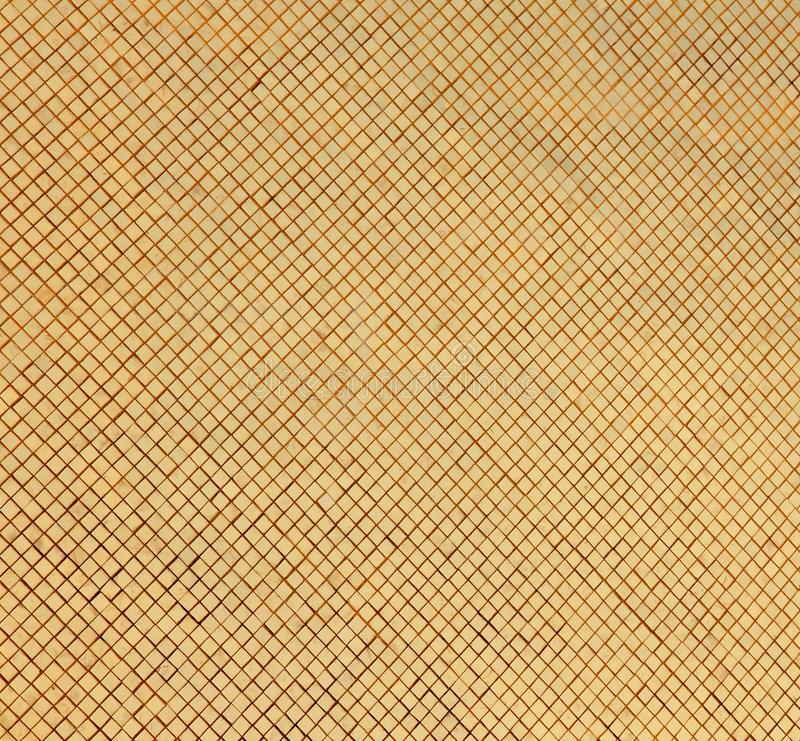 Wall of Golden Tiles stock image